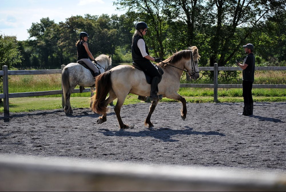 Camille and Cherie get training advice from Haukur Tryggvason at Pur Cheval